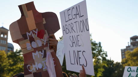 FILE PHOTO: Pro-choice activists take part in a protest march, in Manhattan, New York, October 2, 2021.