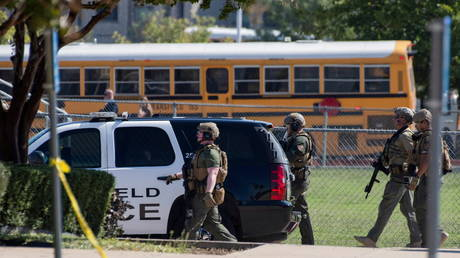 Police secure the school grounds after a shooting at Mansfield Timberview High School in Arlington, Texas, October 6, 2021.