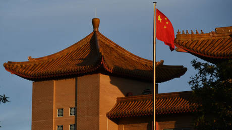 A Chinese flag flies at the Embassy of the People's Republic of China on May 12, 2020 in Canberra, Australia
