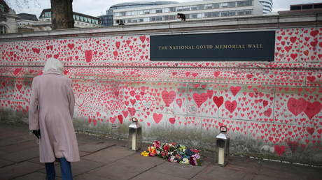 FILE PHOTO: The National Covid Memorial wall beside St Thomas' hospital set as a memorial to all those who have died so far in the UK from COVID-19