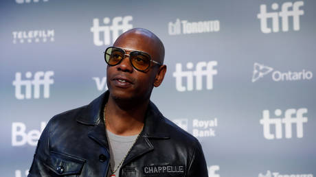 Dave Chappelle arrives for press conference for A Star is Born at the Toronto International Film Festival