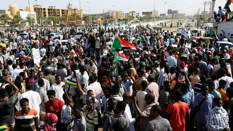 WATCH massive crowds flood Khartoum streets as rival demonstrations are held in Sudanese capital over transitional govt