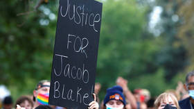 Wisconsin cop who shot Jacob Blake will not face civil rights charges, DOJ says, citing lack of evidence for 'excessive force'