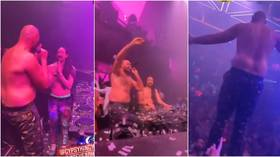 'He's got some stamina!' Shirtless Tyson Fury celebrates with party at Las Vegas nightclub after 11-round war with Wilder (VIDEO)