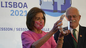 Pelosi receives NATO 'Women for Peace' award, jokes about 'ruling the world'