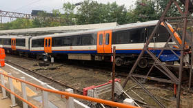 London train comes off tracks after CRASHING through buffers, injuring 2 and forcing station's evacuation (VIDEO, PHOTOS)