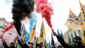 Far-right nationalists march under 'White Lives Matter' banner in Kiev as Ukrainians celebrate 'Defenders and Defendresses Day'