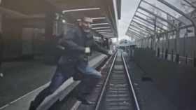 WATCH quick-thinking Moscow Metro train driver stop in SPLIT SECOND after man jumps onto tracks