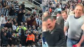 'Hero': Newcastle fan who gave stricken fellow supporter CPR is hailed after dramatic scenes which halted Tottenham match (VIDEO)