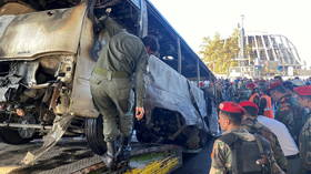 Twin explosions hit army bus in Damascus, killing over a dozen people