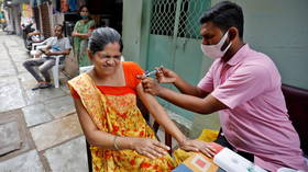 India celebrates landmark 1 BILLION Covid vaccinations, but millions still have yet to receive first dose