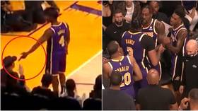 Triggered: NBA fan ejected after Lakers star Rondo 'makes GUN GESTURE' in his face, teammates clash on wild night in LA (VIDEO)
