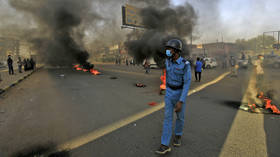 Sudanese police use tear gas as pro-military protesters try to block key roads in Khartoum