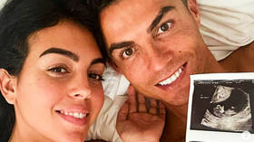 'Can't wait to meet you': Cristiano Ronaldo poses in bed with Georgina Rodriguez as power couple announce they are expecting twins