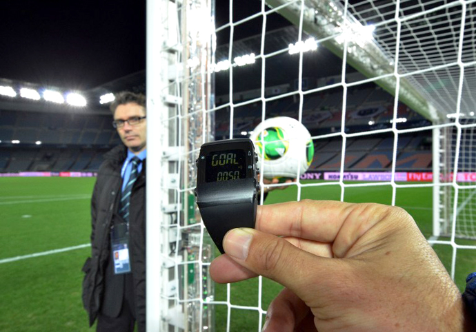 This photo taken on December 5, 2012 shows a FIFA official displaying new goal-line technology developed by GoalRef. (AFP Photo / Yoshikazu Tsuno)
