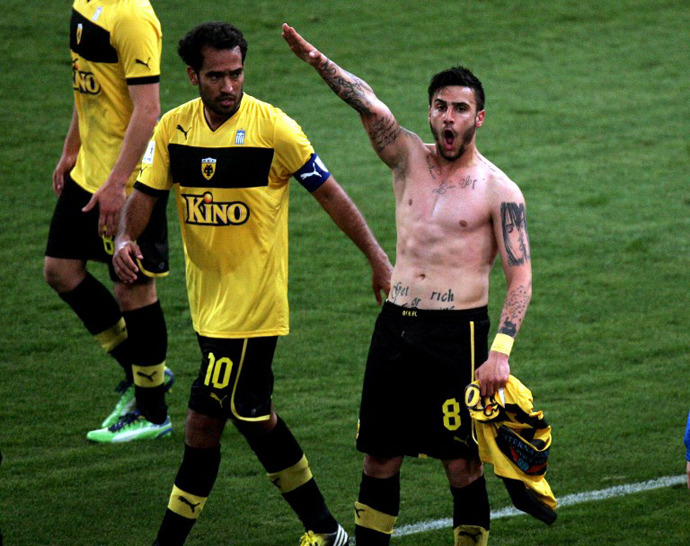 This picture taken on March 16, 2013 shows Giorgos Katidis (R) celebrating a goal with a Nazi salute during a Greek Superleague football game in Athens. Katidis on March 17, was banned for life from playing for Greece for having given a Nazi salute during a game. (AFP Photo)