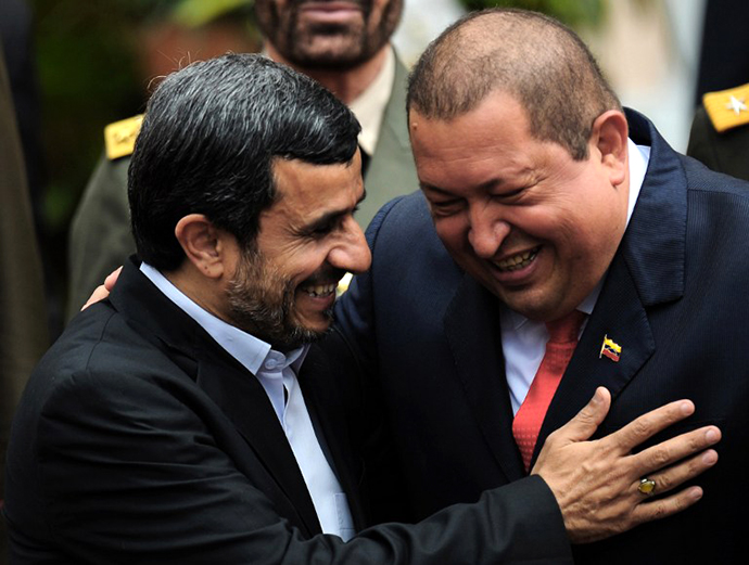 Venezuelan President Hugo Chavez and his Iranian counterpart Mahmoud Ahmadinejad, smile at Miraflores presidential palace in Caracas on January 9, 2012. (AFP Photo / Juan Barreto)