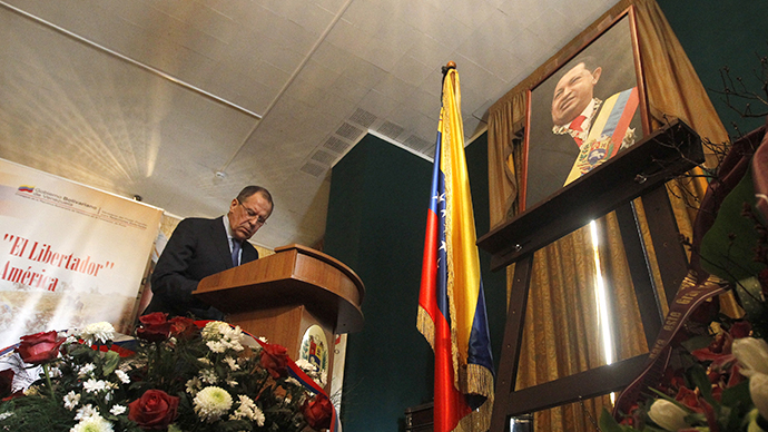 Russia's Foreign Minister Sergei Lavrov writes a condolence book as he visits the Venezuelan embassy to pay his tribute to the late Hugo Chavez in Moscow, March 6, 2013. (Reuters / Maxim Shemetov)