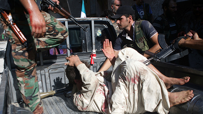 War crime? Syrian rebels execute POWs
