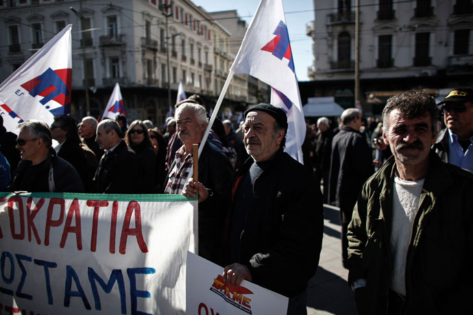 Members of a Greek Communist trade union demonstrate on February 20, 2013 in the center of Athens.(AFP Photo / Angelos Tzortzinis)