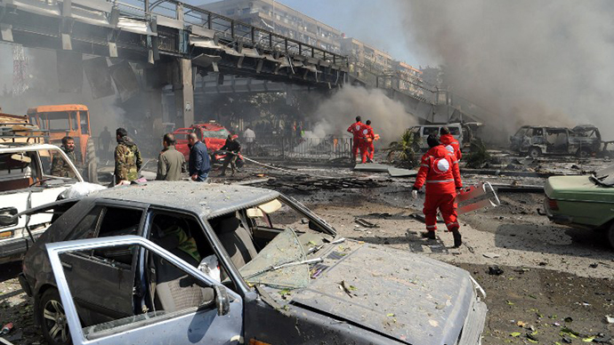 The aftermath of a powerful car bomb explosion near the headquarters of Syria's ruling Baath party in the centre of Damascus. (AFP Photo)