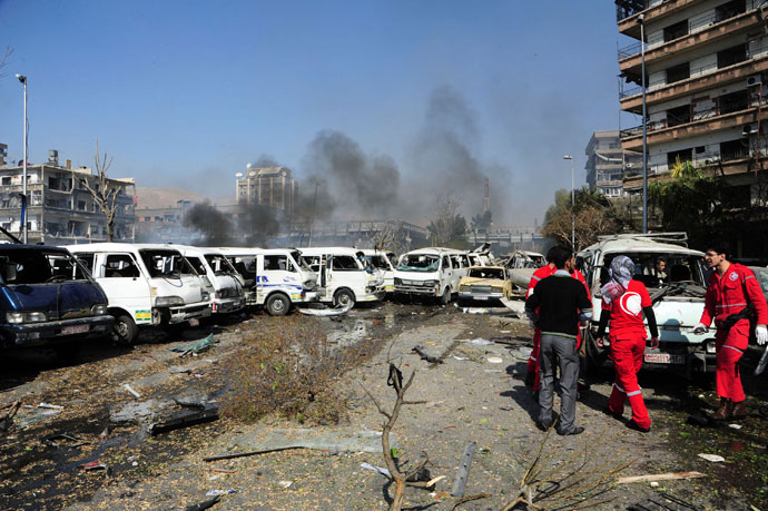 Damaged vehicles and the Russian embassy building (rear C) are seen after an explosion in central Damascus February 21, 2013.(Reuters / Sana)