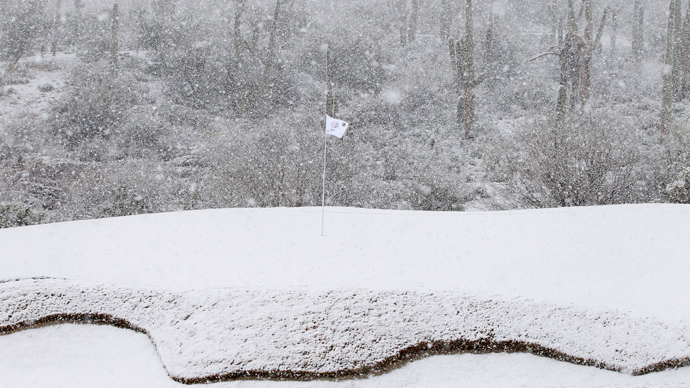 The 18th green is covered in snow as play was suspended during the first round of the WGC-Accenture Match Play Championship golf tournament in Marana, Arizona February 20, 2013 (Reuters / Matt Sullivan)