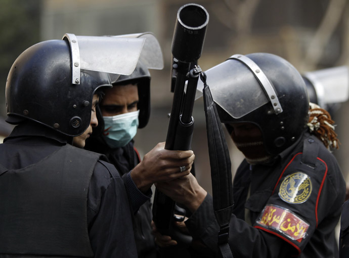 Riot policemen prepare to release tear gas at protesters opposing Egyptian President Mohamed Mursi during clashes along Simon Bolivar Square, which leads to Tahrir Square, in Cairo January 30, 2013. (Reuters/Amr Abdallah Dalsh)