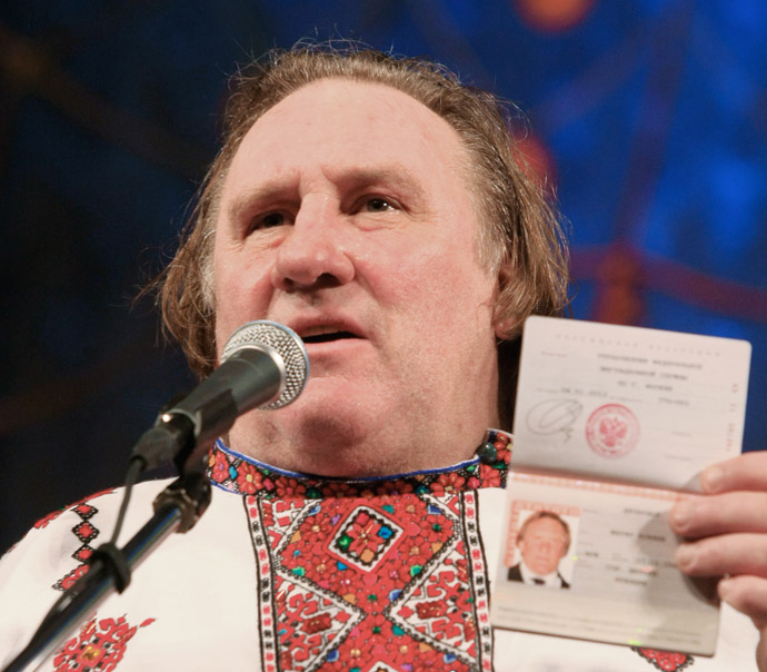 French actor Gerard Depardieu, who was granted Russian citizenship, showing his Russian passport while wearing a Mordovian national shirt at the Theater of Opera and Ballet in Saransk. (RIA Novosti/Julia Chestnova)