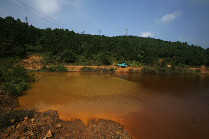 A contaminated lake is seen near Dabaoshan in the northern part of China's Guangdong province. (Reuters / Bobby Yip)