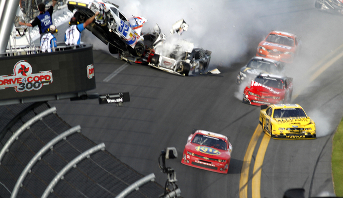 NASCAR driver Tony Stewart avoids a crash to win the NASCAR Nationwide Series DRIVE4COPD 300 race at the Daytona International Speedway in Daytona Beach. (Reuters)