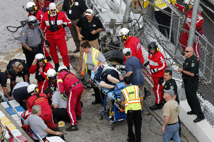 Rescue workers attend to the injured in the stands following a last-lap incident. (Reuters)