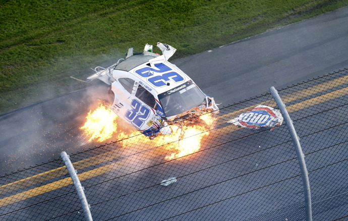 NASCAR driver Kyle Larson's Chevrolet slides on fire down the front stretch on the final lap. (Reuters)