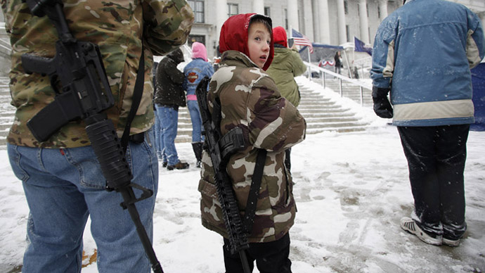 Clint McQueen and his son Chance McQueen, 7, carry rifles at a pro-gun activist rally as part of the National Day of Resistance, at the state Capitol in Salt Lake City, Utah February 23, 2013. (Reuters/Jim Urquhart)