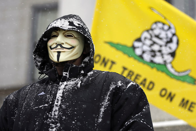 An activist wears a Guy Fawkes mask at a pro-gun rally as part of the National Day of Resistance, at the state Capitol in Salt Lake City, Utah, February 23, 2013. (Reuters/Jim Urquhart)