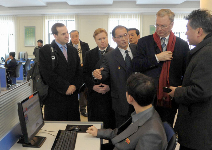 U.S. delegations including Google Executive Chairman Eric Schmidt (2nd R) look at a student using the Internet with desktop computers as he visits Kim Il-Sung University in Pyongyang, in this photo taken by Kyodo January 8, 2013. (Reuters/Kyodo)