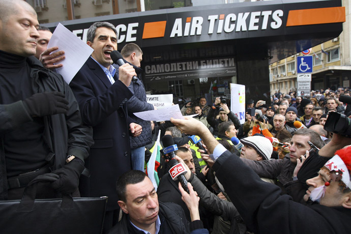Bulgarian President Rosen Plevneliev (2nd L) addresses demonstrators during a protest against high utility bills and monopolies in the energy sector in Sofia February 24, 2013. (Reuters)