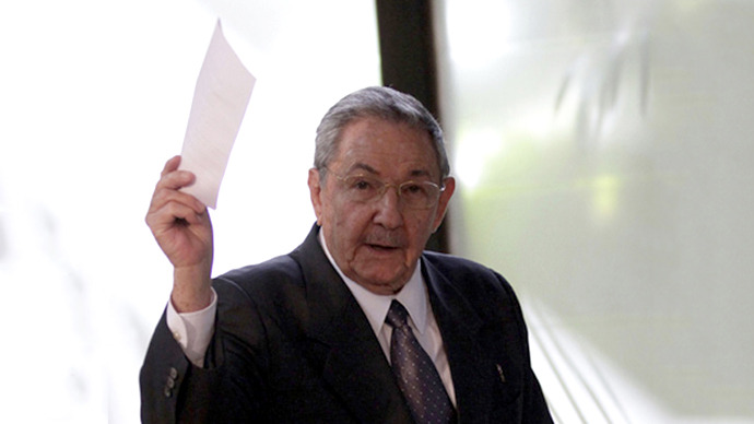 Cuban President Raul Castro shows his voting ballot during the session of the National Assembly of the People's Power in Havana February 24, 2013. (Reuters)
