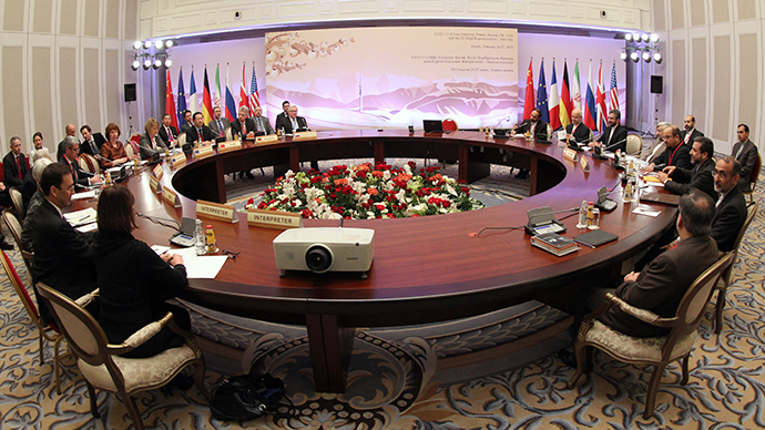World powers and Iran's representatives sit at a table during talks on Iran's nuclear programme in the Kazakh city of Almaty on February 26, 2013. (AFP Photo / Stanislav Filippov))