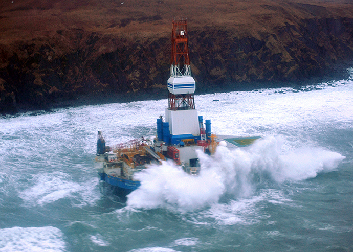 The conical mobile drilling unit Kulluk owned by Royal Dutch Shell agroundaground on the southeast side of Sitkalidak Island, Alaska, January 1, 2013. (AFP Photo / US Coast Guard / Petty Officer)