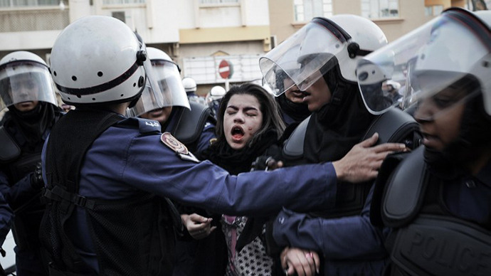 A protestor cries after being pepper sprayed as she is arrested by riot policemen on January 18, 2013. (AFP Photo / Mohammed Al-Shaikh)