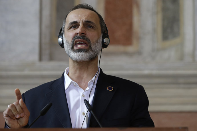 "Syrian National Coalition President Mouaz al-Khatib speaks eduring a joint press conference at the end of a meeting of the ""Friends of the Syrian People (FOSP) Ministerial"" group on February 28, 2013 in Rome. (AFP Photo/Jaquelyn Martin)"