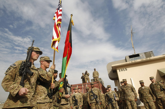 U.S. troops with the NATO led-International Security Assistance Force (ISAF) attend a security transition from NATO troops to Afghan forces in Nangarhar, December 5, 2012. (Reuters/Parwiz)