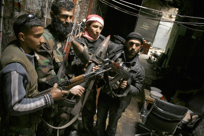Members of the Free Syrian Army hold their weapons in the old city of Aleppo February 11, 2013. (Reuters/Zaid Rev)
