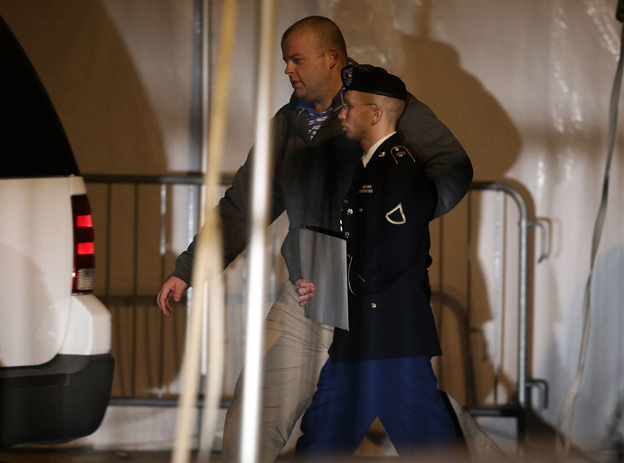 Pfc. Bradley E. Manning is escorted from a hearing, on February 28, 2013 in Fort Meade, Maryland. (Mark Wilson/Getty Images/AFP)