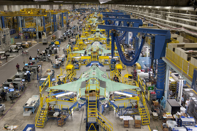 Workers can be seen on the moving line and forward fuselage assembly areas for the F-35 Joint Strike Fighter at Lockheed Martin Corp's factory located in Fort Worth, Texas in this October 13, 2011 handout photo provided by Lockheed Martin. (Reuters/Lockheed Martin/Randy A. Crites)