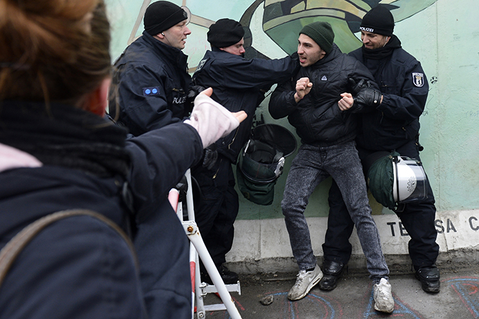 Police arrest an activist during a protest against the removal of a section of the East Side Gallery. (AFP Photo / Odd Andersen)