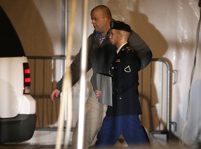Bradley E. Manning is escorted from a hearing, on February 28, 2013 in Fort Meade, Maryland. (AFP Photo / Mark Wilson)