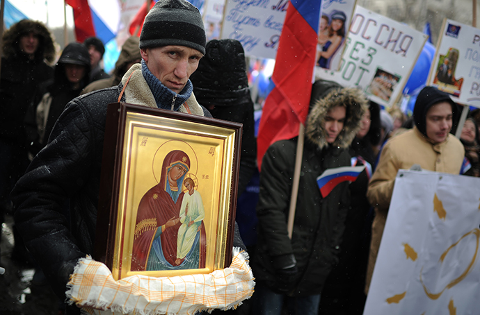 People march during a rally in defence of Russian children in Moscow, March 2, 2013. (RIA Novosti / Ramil Sitdikov)