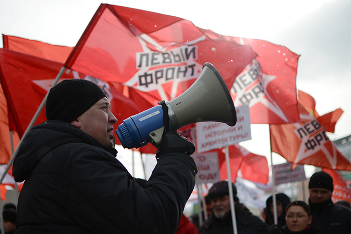 Opposition supporters march in central Moscow, March 2, 2013. Left-wing opposition groups held an anti-government rally to defend the rights of Moscow citizens. (RIA Novosti / Vladimir Astapkovich)